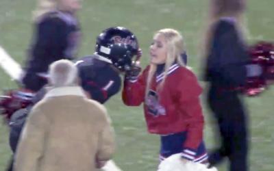 VIRAL VIDEO: Cheerleader Grabs Facemask